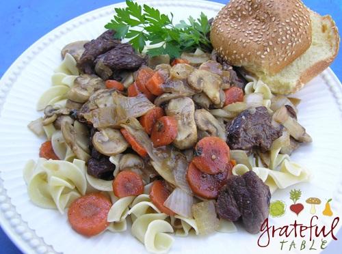 Chuck roast, red wine, and veggies over pasta