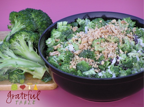 Broccoli Salad topped w/ peanuts, in black bowl