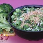 Broccoli Salad topped w/ peanuts, in black bowl