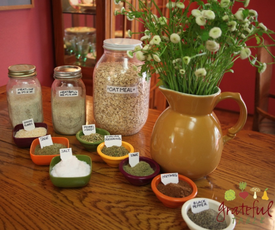 Display of sage, fennel, oats, and others herbs and spices, mixes in jars