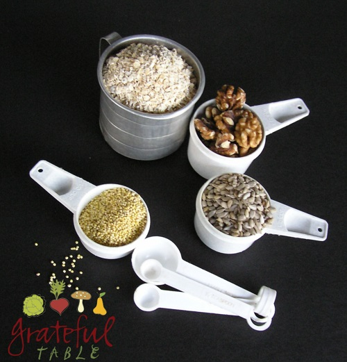 Measuring cup of oats, millet, walnuts, sunflower seeds