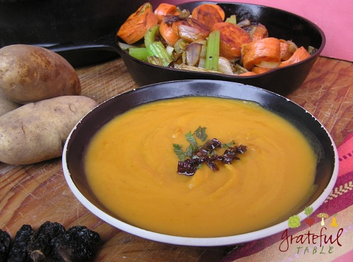 Grilled carrot, onion and celery, plus potatoes and chipotle peppers, make soup