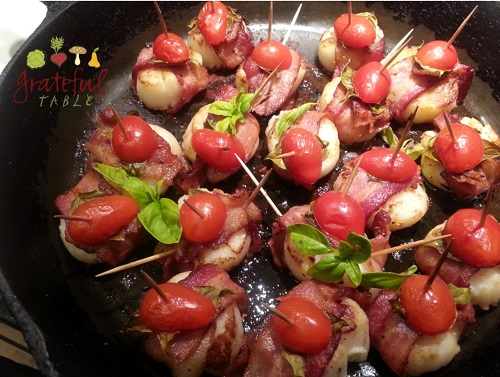 Bacon wrapped scallops w/ basil, cherry tomatoes