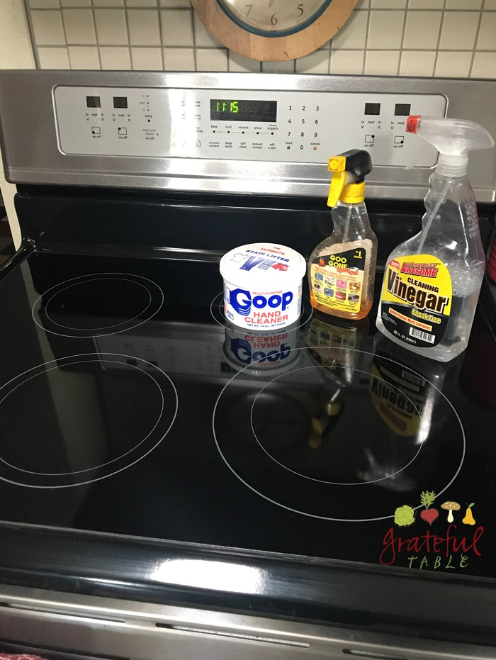how to clean under gas stove top