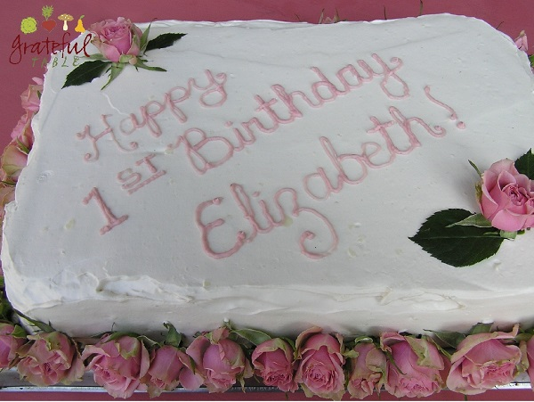 Fancy First Birthday Cake decorated w/ roses