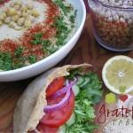 Hummus bowl garnished w/ Parsley, Paprika, Garbanzos